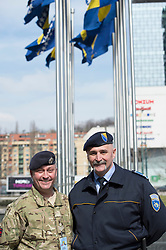 Image shows Staff Sargeant Mark Pearsall, Military Stabilation &amp; Support Group and Almir Seta, BiH Police Protection Unit outside the Ministry of Security in Sarajevo, Bosnia &amp; Herzegovina (BiH). 17/03/2015.<br /> <br /> The press conference was attended by representatives of the BiH governmment and the British Ambassador to BiH, Edward Furguson and Brigadier Alistair Aitkin, Commander Security Assistance Group (77 Brigade).<br /> <br /> Credit should read: Cpl Mark Larner, Media Ops Group.<br /> <br /> Exercise Civil Bridge is an exercise in support of UK Defence Engagement by elements of 77 Brigade. Civil Bridge 14B (CB14B) is being conducted Sarajevo, Bosnia &amp; Herzegovina (BiH).<br /> <br /> By assisting the BiH Government to develop their contingency plans for natural disasters at both strategic and operational levels, CB14B will contribute to the long term international effort to stabilise BiH ethnic groups and authorities.