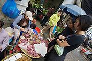 Hom Market. Selling meat in the street.