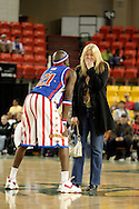 "04 May 2006: Kevin ""Special K"" Daley pleads for a kiss from Rene Legruc of Anchorage after stealing her purse during the Harlem Globetrotters vs the New York Nationals at the Sulivan Arena in Anchorage Alaska during their 80th Anniversary World Tour.  This is the first time in 10 years that the Trotters have visited Alaska."