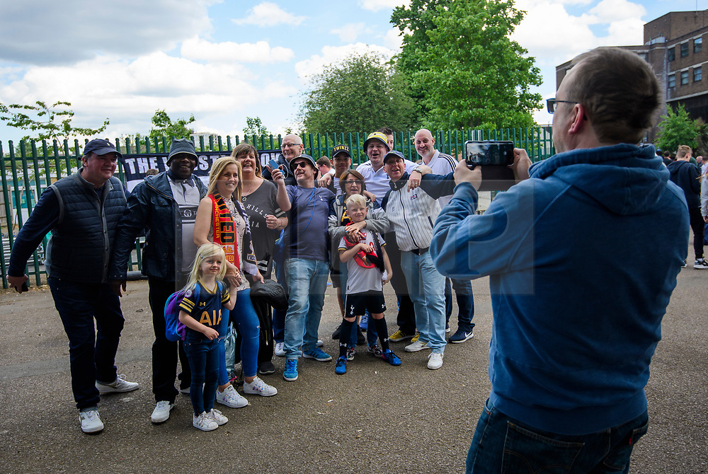 © Licensed to London News Pictures. 14/05/2017. London, UK. Fans pose for a picture outside White Heart Lane, in North London where Tottenham Hotspur F.C. are playing their final game at the ground, against Manchester united today (Sun). Known as 'The Lane', Tottenham have been playing at the ground for 118 years, but will be playing at Wembley next season while a new 60,000 seat stadium is built for the start of the 2018/19 season.  Photo credit: Ben Cawthra/LNP