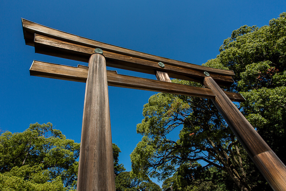A massive wooden tori gate marks the entrance to the Meiji Shrine, near Akihabara Station, Tokyo.