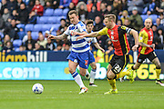 Reading FC striker (31) Simon Cox holds off Birmingham City defender (28) Michael Morrison during the Sky Bet Championship match between Reading and Birmingham City at the Madejski Stadium, Reading, England on 9 April 2016. Photo by Mark Davies.