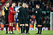 Liverpool midfielder Jordan Henderson (14) and Liverpool goalkeeper Adrian (13) let the match officials know their thoughts after the Premier League match between Liverpool and Brighton and Hove Albion at Anfield, Liverpool, England on 30 November 2019.