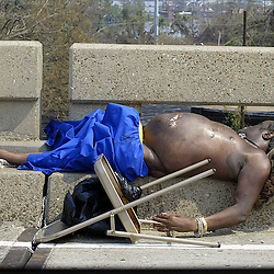 A body of a man was left on the Interstate 10 just north of the SuperDome during the aftermath of Hurricane Katrina Saturday, September 3, 2005 in New Orleans, Louisiana.  <br /> (Pasadena Star-News Keith Birmingham)