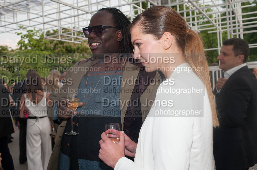 DAVID OKUMU; ROSIE LOWE; , The Serpentine Summer Party 2013 hosted by Julia Peyton-Jones and L'Wren Scott.  Pavion designed by Japanese architect Sou Fujimoto. Serpentine Gallery. 26 June 2013. ,