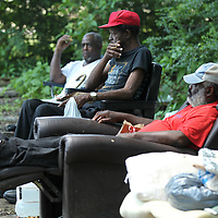 Tommy Terrell, Michael Neal and Robert Cayson, homeless residents in Tupelo, sit at their camp during a visit by Perry Burkart on Thursday afternoon.