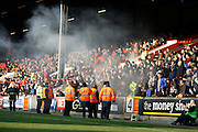 Notts County fans celebrate by lighting a flare during the EFL Sky Bet League 2 match between Leyton Orient and Notts County at the Matchroom Stadium, London, England on 18 February 2017. Photo by Andy Walter.