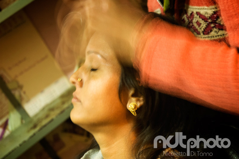 A woman during a head massage as part of her hairdressing. Rajasthan, India