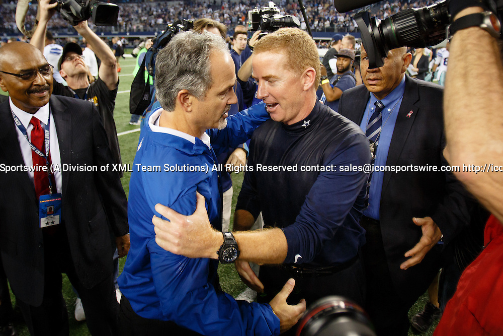 21 DEC 2014: Dallas Cowboys Head Coach Jason Garrett and Indianapolis Colts Head Coach Chuck Pagano shake hands after the NFL game between the Dallas Cowboys and the Indianapolis Colts at AT&T Stadium in Arlington, TX.  Dallas wins 42-7.