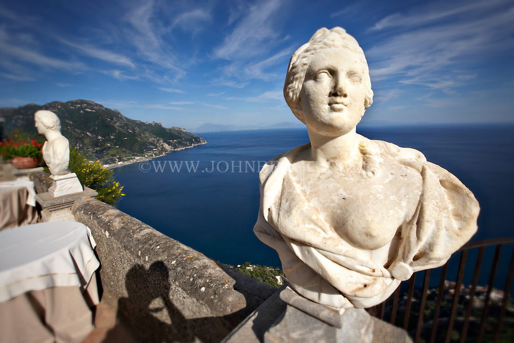 The Amalfi Coast and old statues taken from the Terrace of the Infinite, Ravello, Italy.