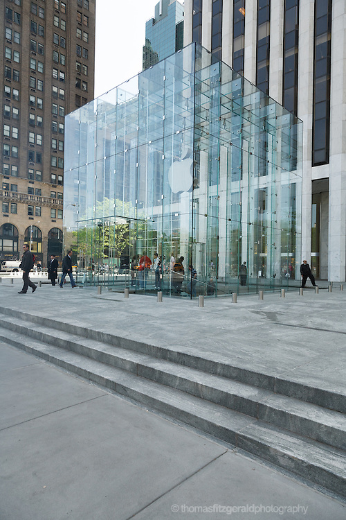 New York City, USA, May 2006: Shoppers and Tourists visit the iconic Apple Store on 5th Avenue, In New York City
