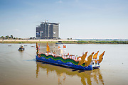 "05 FEBRUARY 2013 - PHNOM PENH, CAMBODIA:   The Royal Barge carrying the ashes of King-Father Norodom Sihanouk heads up the Mekong River to scatter the revered King's ashes. Sihanouk's ashes will be scattered in locations across Cambodia. Tuesday, they were scattered on the Mekong River. Norodom Sihanouk (31 October 1922 - 15 October 2012) was the King of Cambodia from 1941 to 1955 and again from 1993 to 2004. He was the effective ruler of Cambodia from 1953 to 1970. After his second abdication in 2004, he was given the honorific of ""The King-Father of Cambodia."" Sihanouk died in Beijing, China, where he was receiving medical care, on Oct. 15, 2012.  PHOTO BY JACK KURTZ"