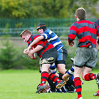 Ennis V Old Crescent at Thomand park on Saturday 11th November. Pictured is Daragh Cooney being tackled by John Randalls.<br />Pic. Emma Jervis/ Press 22