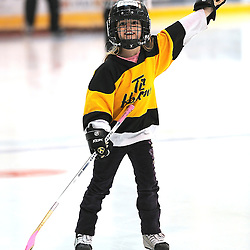 LINDSAY, ON - Feb 14 : Ontario Junior Hockey League Game Action between the Lindsay Muskies and the Toronto Jr. Canadiens, afer cleaning up from the chuck a puck conest this young lady waves to the crowd before second period game action.<br /> (Photo by Andy Corneau / OJHL Images)