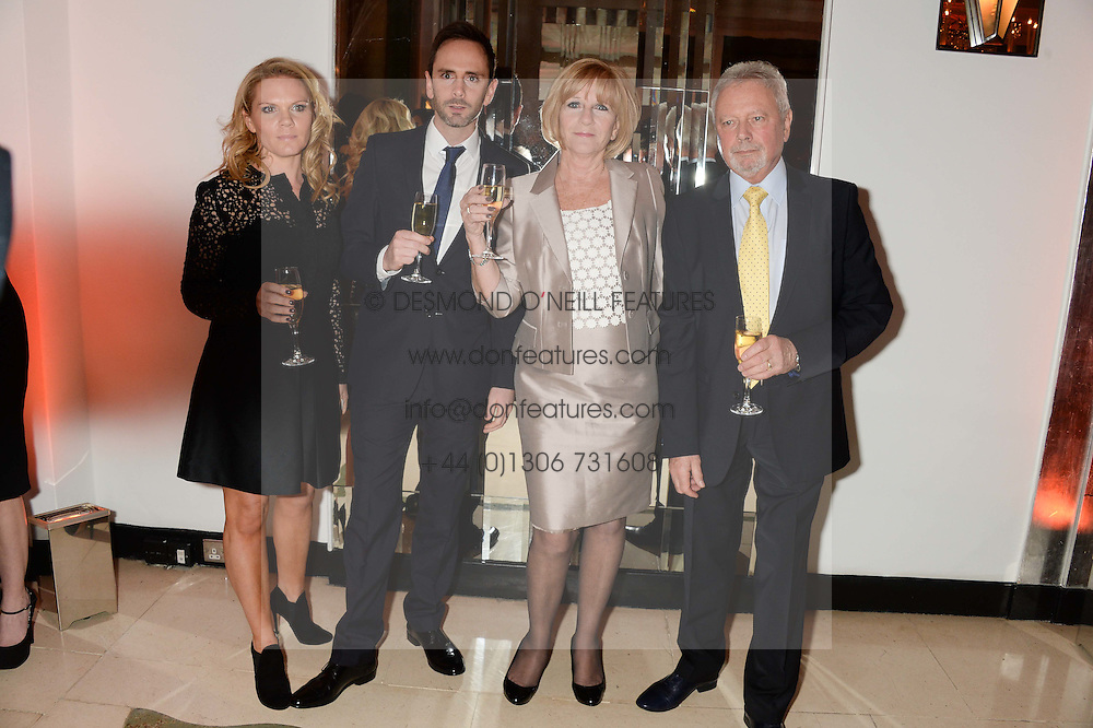 Left to right, LOUISE ADAMS, brother CHRISTIAN ADAMS and TONY & JACKIE ADAMS parents of Victoria Beckham at the Harper???s Bazaar Women of the Year 2013 in association with Estée Lauder, Audemars Piguet and Selfridges & Co. held at Claridge's, Brook Street, London on 5th November 2013.