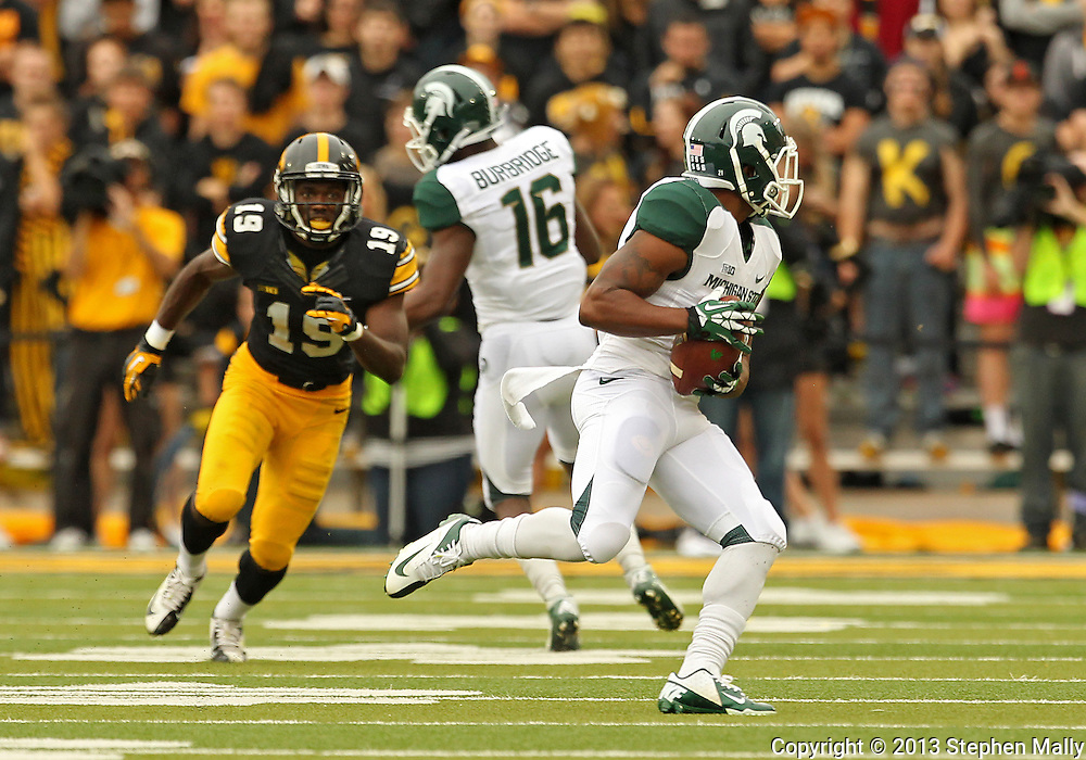 October 6 2013: Michigan State Spartans wide receiver Andre Sims Jr. (21) pulls in a pass during the first quarter of the NCAA football game between the Michigan State Spartans and the Iowa Hawkeyes at Kinnick Stadium in Iowa City, Iowa on October 6, 2013. Michigan State defeated Iowa 26-14.