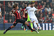 Nathan Ake (5) of AFC Bournemouth challenges Luka Milivojevic (4) of Crystal Palace during the Premier League match between Bournemouth and Crystal Palace at the Vitality Stadium, Bournemouth, England on 7 April 2018. Picture by Graham Hunt.