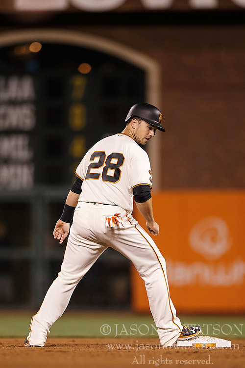 SAN FRANCISCO, CA - APRIL 18: Buster Posey #28 of the San Francisco Giants stands on second base against the Arizona Diamondbacks during the fifth inning at AT&T Park on April 18, 2016 in San Francisco, California. The Arizona Diamondbacks defeated the San Francisco Giants 9-7 in 11 innings.  (Photo by Jason O. Watson/Getty Images) *** Local Caption *** Buster Posey