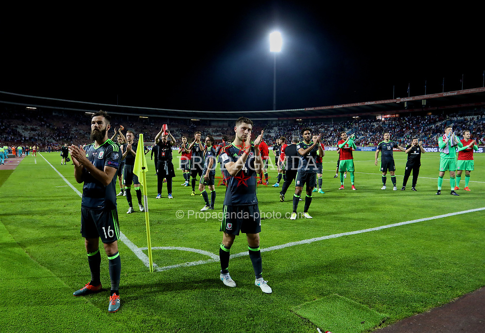 BELGRADE, SERBIA - Sunday, June 11, 2017: Wales' Joe Ledley and Ben Davies applaud the supporters after the 1-1 draw during the 2018 FIFA World Cup Qualifying Group D match between Wales and Serbia at the Red Star Stadium. (Pic by David Rawcliffe/Propaganda)