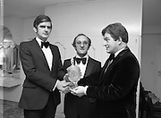 "Car Of The Year Award.    (N58)..1981..22.01.1981..01.22.1981..22nd January 1981..At a reception in Dublin,Mr Enda Hogan, Director and General Sales Manager of Ford Ireland received the ""Car of the Year"" awardfrom the Chairman of the Irish Motoring Writers' Association. The members of the association voted the new Ford Escort car of the year..Image shows (L-R) Mr Enda Hogan,Director and General Sales Manager of Ford Ireland, Mr Frank Corr, Hon Secretary of the Irish Motoring Writers' Association and Mr Andrew Hamilton,Chairman of the Irish Motoring Writers' Association who made the presentation."