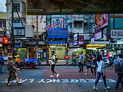 "01 AUGUST 2018 - BANGKOK, THAILAND:     Tourists walk past ""Emergency Lane"" recently stenciled on Khao San Road in Bangkok. Street market venders are not supposed to set up in the emergency lane areas. Khao San Road is Bangkok's original backpacker district and is still a popular hub for travelers, with an active night market and many street food stalls. The Bangkok municipal government went through with it plans to reduce the impact of the street market on August 1 because city officials say the venders, who set up on sidewalks and public streets, pose a threat to public safety and could impede emergency vehicles. Venders are restricted to working from 6PM to midnight and fewer venders will be allowed to set up on the street. It's the latest in a series of night markets and street markets the city has closed.    PHOTO BY JACK KURTZ"