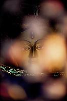 Kathmandu, 13 February 2005. Buddha's sculpture at the Swayambhunath Temple
