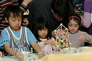(left to right) Jordan Lee, 7; Carissa Lee, 4; both from Springboro and Avery Morrison, 4, from Centerville learn engineering by building with spice drops and toothpicks at the American Society of Civil Engineers (ASCE) booth during the 5th Annual TechFest<br />