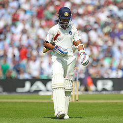 India's Ajinkya Rahane out for 0 c and b by England's Chris Jordan during the first day of the Investec 5th Test match between England and India at the Kia Oval, London, 15th August 2014 © Phil Duncan | SportPix.org.uk