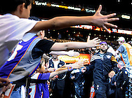 Jan. 8, 2012; Phoenix, AZ, USA; Fans high five Phoenix Suns small forward Jared Dudley (3) runs out of the tunnel prior to a game against the Milwaukee Bucks at the US Airways Center. Mandatory Credit: Jennifer Stewart-US PRESSWIRE..