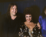 Elizabeth Taylor and Meatloaf at a celebration of the re-opening of Wolftrap (after a fire in 1982), in February 1983...Photograph by Dennis Brack b23
