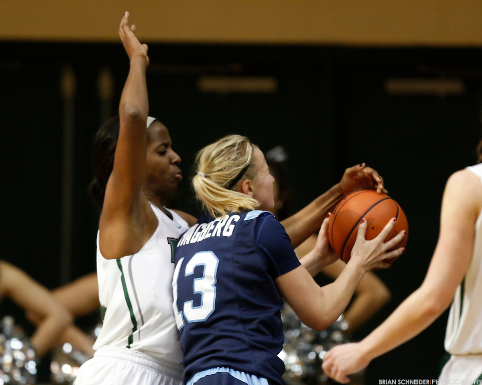 January 6, 2012; Baltimore, MD, USA; Loyola Maryland Greyhounds forward Nneka Offodile (31) defends Saint Peter's Peacocks forward Lovisa Hagberg (13) in the second half at Reitz Arena in Baltimore, MD. Mandatory Credit: Brian Schneider-www.ebrianschneider.com