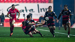 Dragons' Sam Beard offloads despite the tackle of Scarlets' James Davies<br /> <br /> Photographer Craig Thomas/Replay Images<br /> <br /> Guinness PRO14 Round 13 - Scarlets v Dragons - Friday 5th January 2018 - Parc Y Scarlets - Llanelli<br /> <br /> World Copyright © Replay Images . All rights reserved. info@replayimages.co.uk - http://replayimages.co.uk