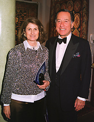MR & MRS JOHN RITBLAT he is the multi millionaire property developer, at a dinner in London on 19th May 1999.MSF 60