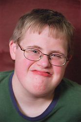 Portrait of boy with Downs Syndrome,