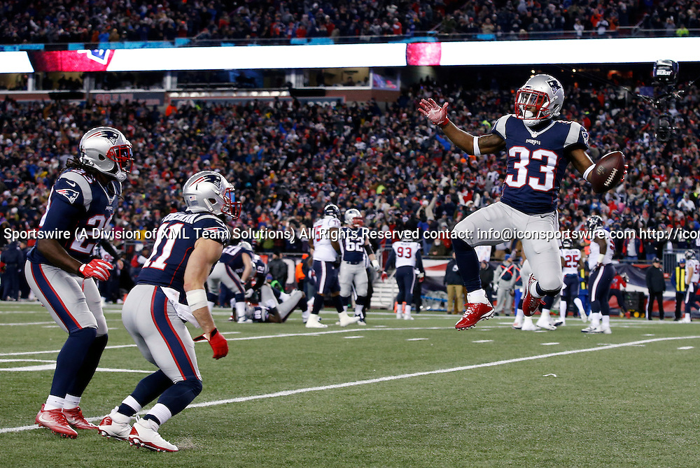 FOXBOROUGH, MA - JANUARY 14: New England Patriots running back Dion Lewis (33) celebrates his rushing touchdown with New England Patriots wide receiver Julian Edelman (11) and New England Patriots running back LeGarrette Blount (29) during an AFC Divisional Playoff game between the New England Patriots and the Houston Texans on January 14, 2017 at Gillette Stadium in Foxborough, Massachusetts. The Patriots defeated the Texans 34-16.  (Photo by Fred Kfoury III/Icon Sportswire)