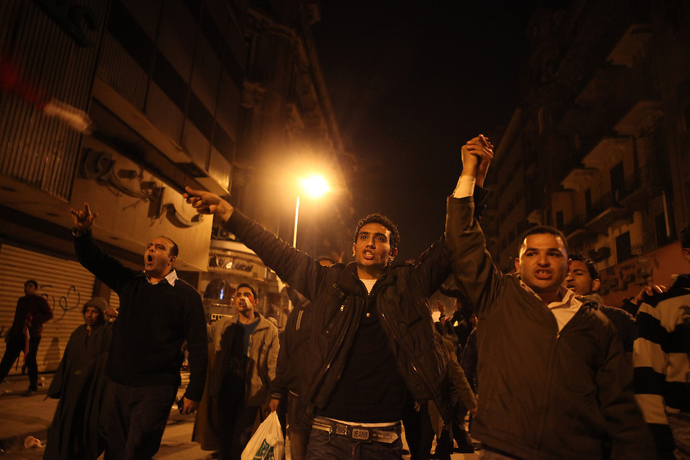 Pro-democracy protesters march toward Tahrir Square after watching a televised speech by then President Hosni Mubarak where he refused to step down on 1 February.