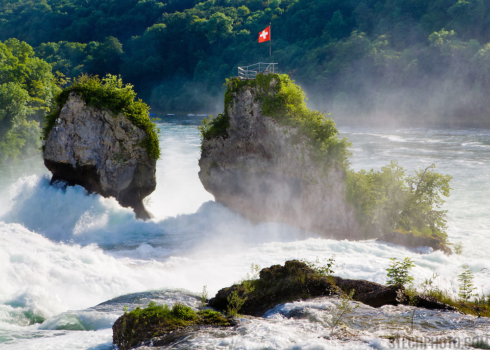 A section of the Rhine Falls (Rheinfall) near the towns of Neuhausen am Rheinfall and Schaffhausen, Switzerland. They're located on the High Rhine River and are the largest plain falls in Europe.