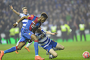 Crystal Palace midfielder Wilfried Zaha evades the tackle during the The FA Cup Quarter Final match between Reading and Crystal Palace at the Madejski Stadium, Reading, England on 11 March 2016. Photo by Mark Davies.