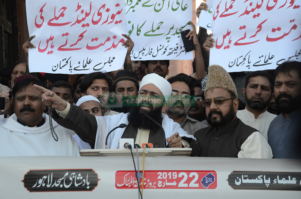 March 22, 2019 - Lahore, Punjab, Pakistan - Pakistani great Imam & Khateeb Badshahi Mosque, Hazrat Molana Syed Muhammad, Abd-ul-Khabir Azad  and other religious leaders holding a banner reads ''protest against attacks on New Zealand mosques,'' rally after a Friday prayers organized by Majid-e-Ulema Pakistan in front of historical  Badshahi Mosque in Lahore. (Credit Image: © Rana Sajid Hussain/Pacific Press via ZUMA Wire)