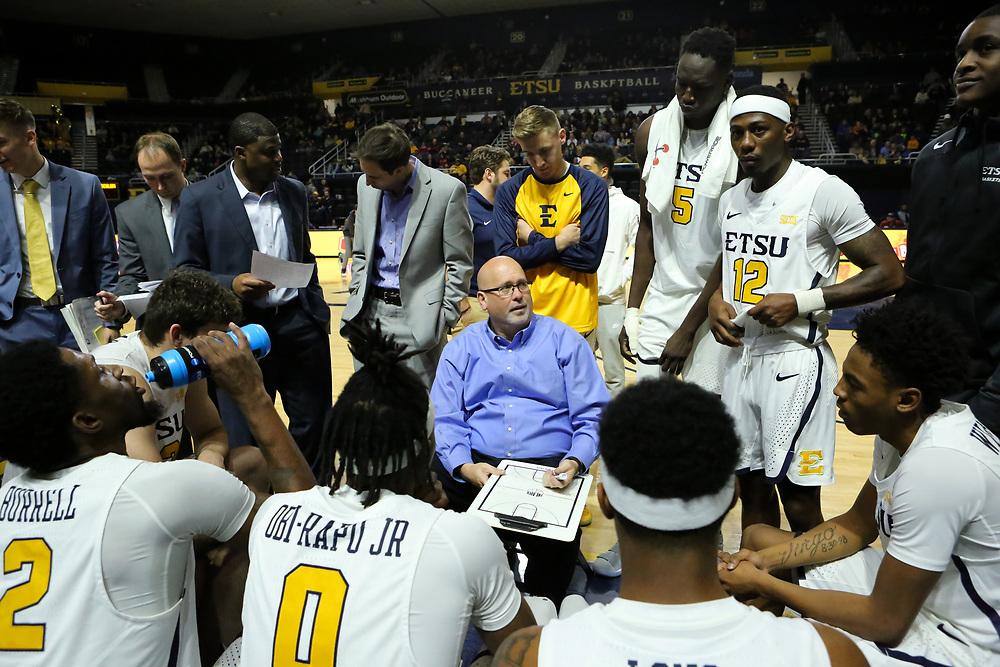 December 28, 2017 - Johnson City, Tennessee - Freedom Hall: ETSU head coach Steve Forbes, ETSU center Peter Jurkin (5), ETSU guard Jalan McCloud (12)<br /> <br /> Image Credit: Dakota Hamilton/ETSU