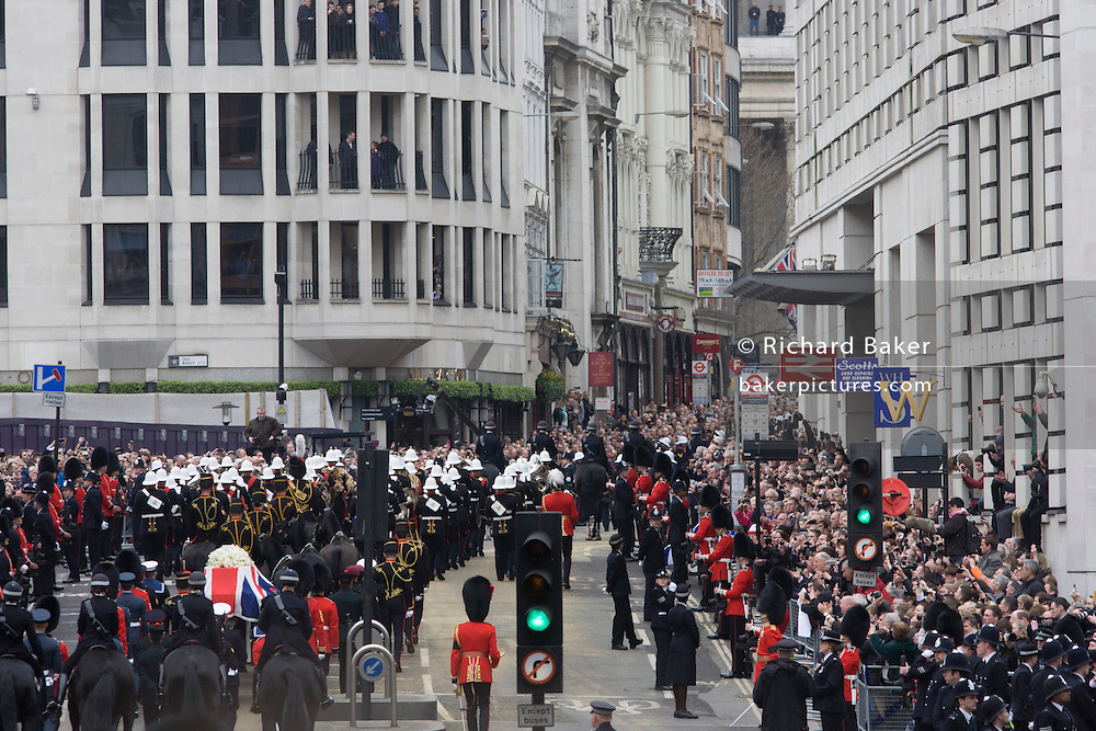 London 17/4/13 - The coffin of Margaret Thatcher climbs Ludgate Hill before her funeral in St Paul's Cathedral. Draped in the union flag and mounted on a gun carriage, the coffin of ex-British Prime Minister Baroness Margaret Thatcher's coffin travels along Fleet Street the Cathedral in London, England. Afforded a ceremonial funeral with military honours, not seen since the death of Winston Churchill in 1965, family and 2,000 VIP guests (incl Queen Elizabeth) await her cortege.