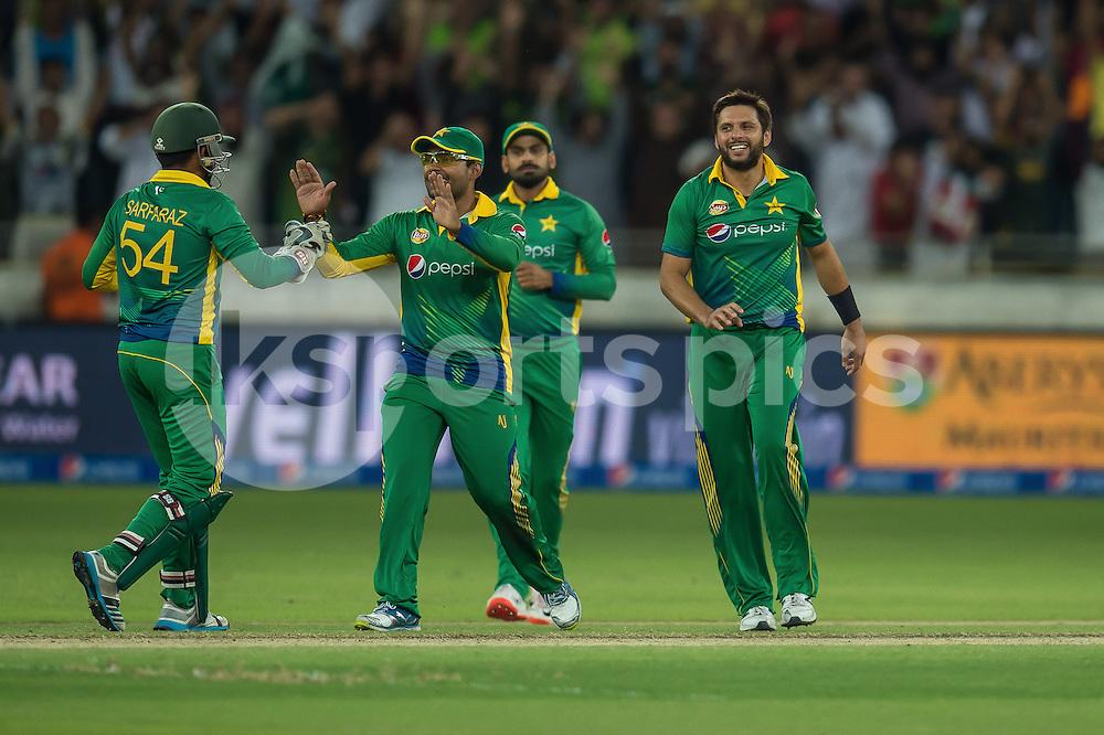 Pakistan celebrate the wicket of Jason Roy of England during the 2nd International T20 Series match between Pakistan and England at Dubai International Cricket Stadium, Dubai, UAE on 27 November 2015. Photo by Grant Winter.