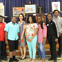 Belle-Shivers Middle School gifted arts teacher Valerie Brahan poses with students who participated in the school's recent art show.
