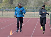 LaShawn Merritt (left) and Francena McCorory run during a workout in Kissimmee, Fla., Thursday, Jan. 25, 2018.