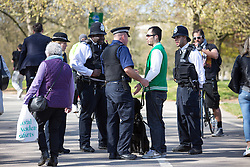 © Licensed to London News Pictures. 20/04/2016. London, UK. Police search members of the public entering Hyde park ahead of the '4/20' demonstration. Demonstrators gather on 20 April for the legalisation of cannabis. Photo credit : Tom Nicholson/LNP