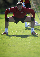 Photo: Paul Thomas.<br />Manchester United training session. UEFA Champions League. 06/03/2007.<br />Man Utd's Gary Neville stretches during training.