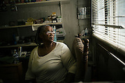 PANOLA, AL – OCTOBER 9, 2015: An attendant works at R&D's General Store, the only store where food is sold in Penola. Due to state budget cuts, Alabama announced the closure of 31 of its driver's license offices in mostly rural sections of the state, where poverty is high and transportation is notoriously difficult. Critics argue the closures are an attempt to limit accessibility to photo IDs – which are now required for voting – but state officials insist that the closings have no effect on access to photo ID. CREDIT: Bob Miller for The New York Times