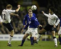 Fotball<br /> Photo. Aidan Ellis, Digitalsport<br /> NORWAY ONLY<br /> <br /> Everton v Tottenham Hotspur.<br /> FA Barclaycard Premiership.<br /> 09/04/2004.<br /> everton's Brian McFadden gets inbetween Spurs Gary Doherty and Jamie Redknapp