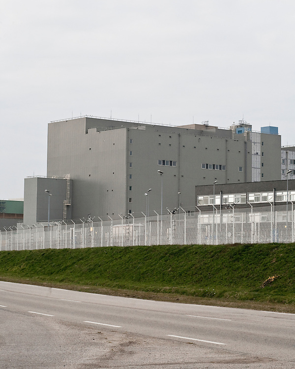 The security electric fence around the buildings of the nuclear reprocessing plant of La Hague. This site of the Areva company is one of the few in the world with the ability of recycling used nuclear fuel and producing MOX fuel. Ecologists have denounced the danger of this material particulary polluting. They also have revealed high concentration of air pollution in the villages around the plant.