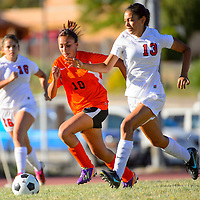 100113  Adron Gardner/Independent<br /> <br /> Gallup Bengal Desirea Madrid (10), left and Grants Pirate Rita Sarracino (13) chase a ball in Grants Tuesday.